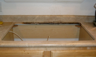 sink removed showing hole in countertop