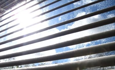 open blinds and curtains to let sun in and heat your house