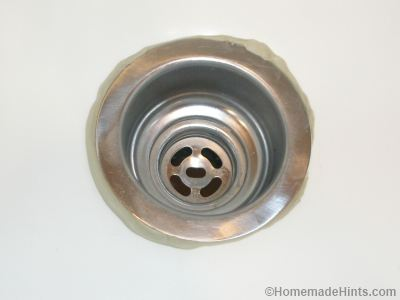 remove excess putty from kitchen sink drain